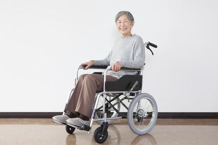 fostering: Wheelchair senior woman portrait