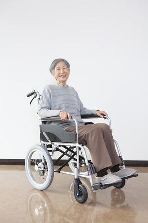 health care facility: Wheelchair senior woman portrait