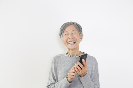 retirement age: Grandma with a smartphone