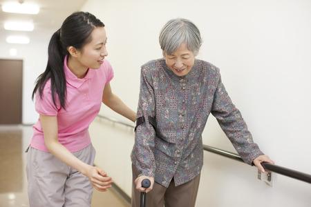 Grandma on crutches and walking training