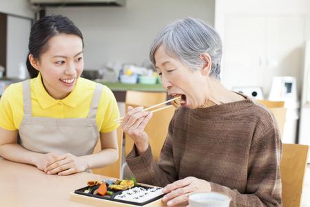 Granny eats lunch Standard-Bild