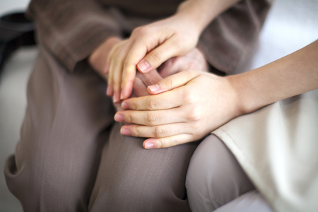 Caregivers hand rolled Stock Photo