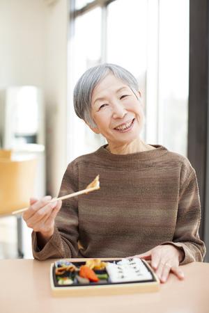 Granny eats lunch 스톡 콘텐츠