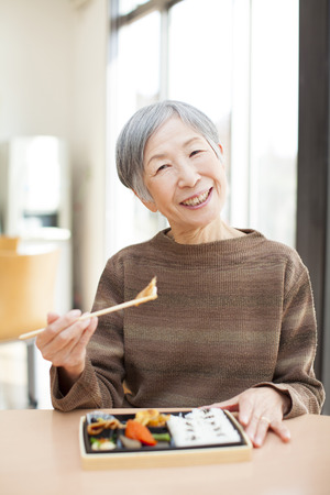 Granny eats lunch Stock Photo