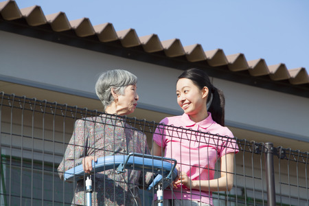 social work aged care: Caregivers balcony overlooking and Grandma