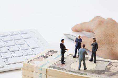 consider: Businessmen consider investment figures Stock Photo