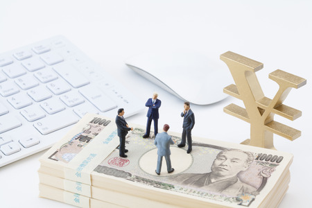 Businessmen consider investment figures 写真素材