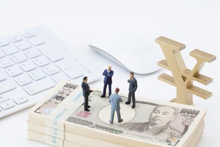 Businessmen consider investment figures 스톡 콘텐츠