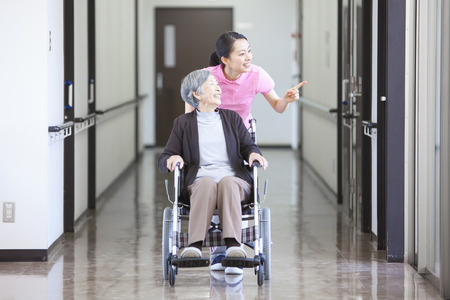 nursing aid: Grandma took care and wheelchairs