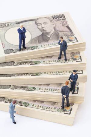 net meeting: Businessmen discuss money figures Stock Photo