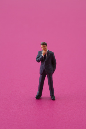 scaled down: figure of businessman to think