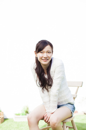 outdoor chair: Woman sitting in an outdoor Chair