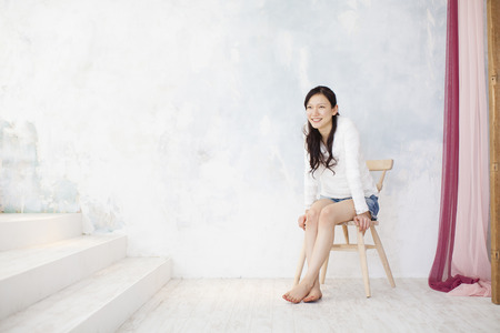 loosen up: Woman sitting on a Chair