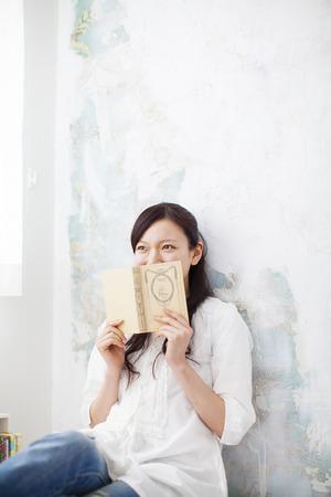 loosen up: Girl reading a book Stock Photo