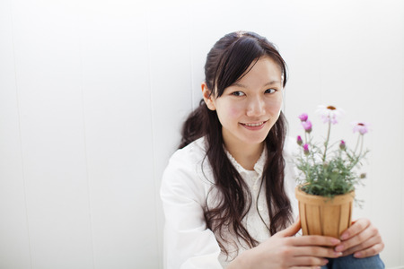 Women with potted flowers