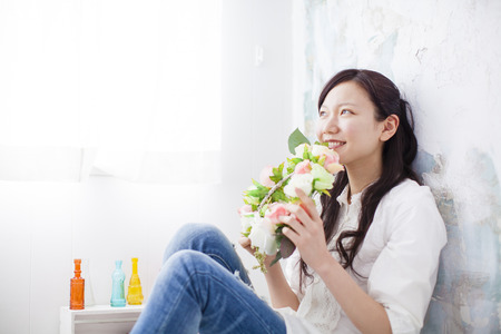 loosen up: Woman sitting with flowers