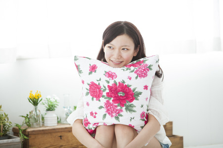 loosen up: Women who have had a cushion Stock Photo