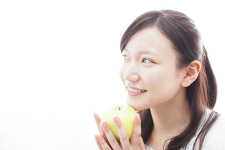 Women who have an apple Stock Photo