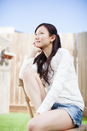 neatness: Woman sitting in an outdoor Chair