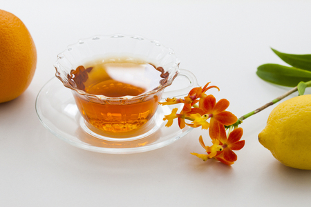 gradual: Tea and orchid flower Stock Photo