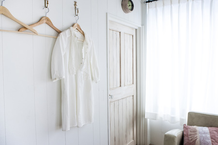 one piece dress: Clothes hung on the wall