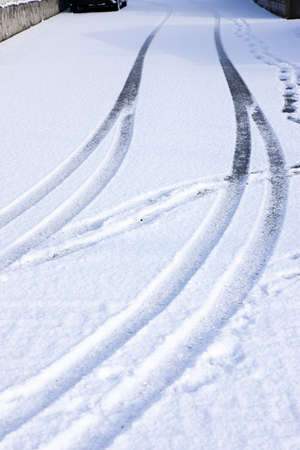tire marks: Tire marks of a car left in the snow Stock Photo