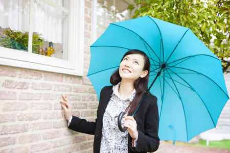 put up: Women put up an umbrella