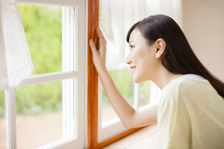 looking out: Woman looking out window