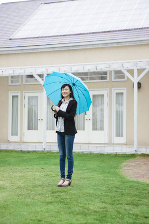 Women put up an umbrella
