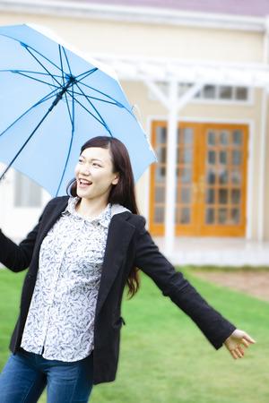frolic: Women frolic with umbrella Stock Photo