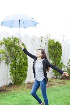 Women frolic with umbrella 스톡 콘텐츠