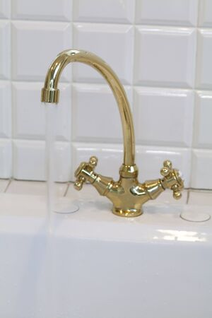 a detached living room: Retro faucet