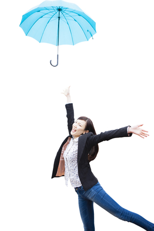 to toss: Women who toss the umbrella Stock Photo