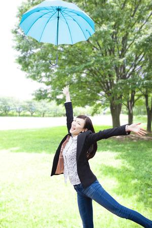 Women who toss the umbrella Stock Photo