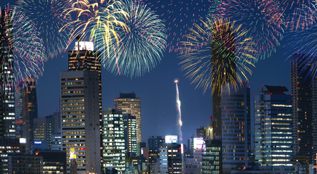 to go up: Fireworks go up out in downtown buildings