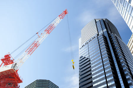 urban redevelopment: Crane vehicles and buildings Stock Photo