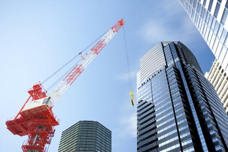 urban redevelopment: Crane vehicles and buildings Stock Photo