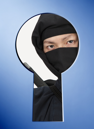 peek: Ninja peek through the keyhole Stock Photo