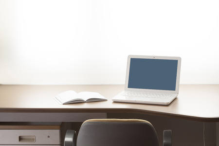 teaching material: Desk and laptop Stock Photo