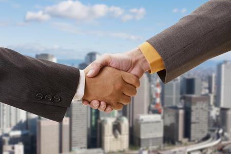 kita: Shaking hands Stock Photo