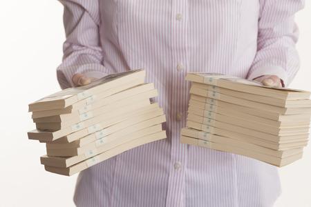 Women with bundle of bills 写真素材