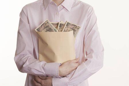 woman holding money: Woman holding money