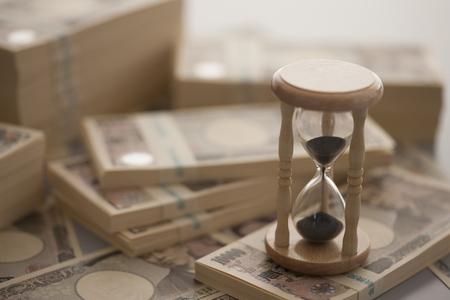 Money and hourglass