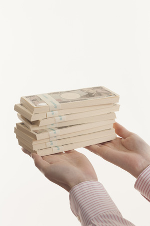 plural number: Women with bundle of bills Stock Photo