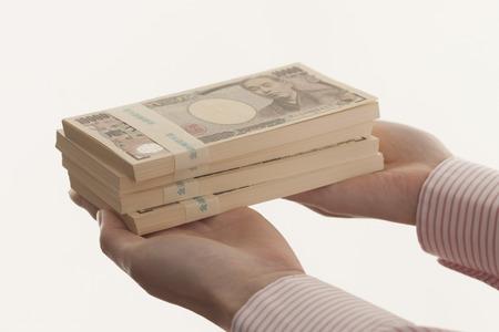 Women with bundle of bills Stock Photo