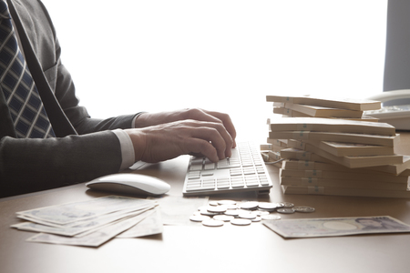 Office desk with money   Stock Photo