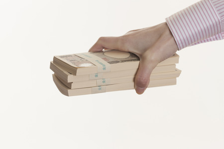 bundle: Women with bundle of bills Stock Photo