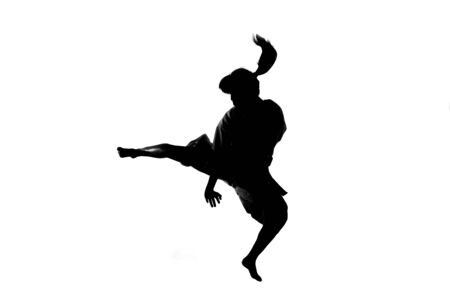 martial arts woman: Silhouette of woman in shorinji kempo Stock Photo