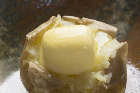 buttered: Buttered potato Stock Photo