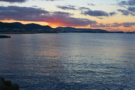 afterglow: Sunset clouds and afterglow shine on the surface of the water of Gyeongpo
